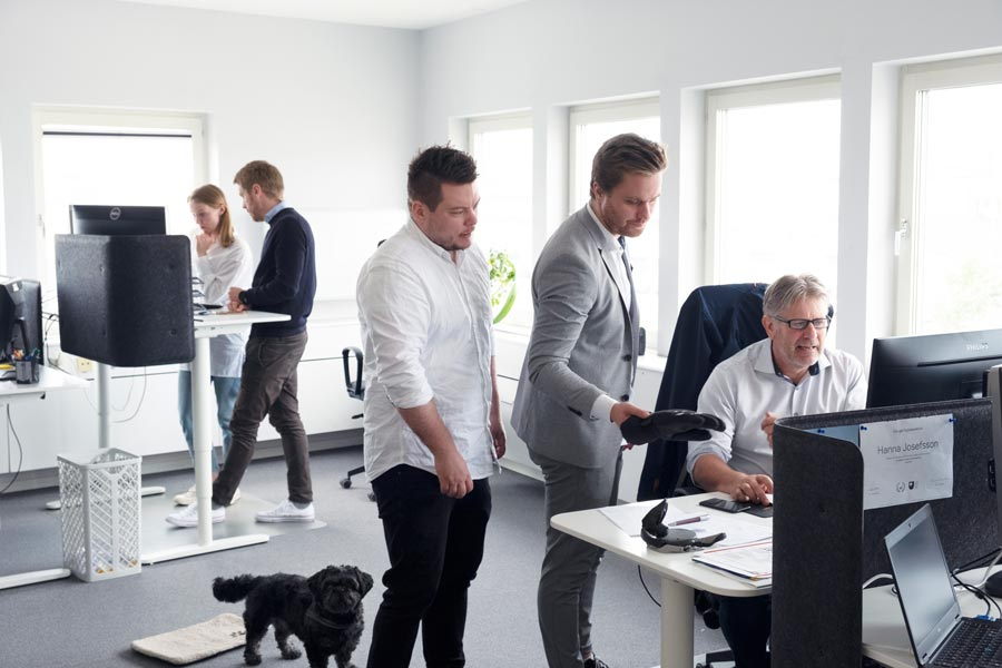 Employees standing in office